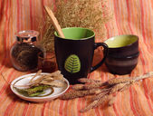 Still life with dried herbs, cups, bowls — Stock Photo