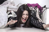 Panicked girl buried under mess — Stock Photo