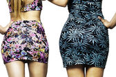 Women wearing floreal dresses backside — Stock Photo