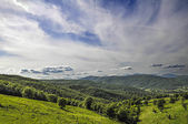 Italian landscape with hills and clouds — Stockfoto