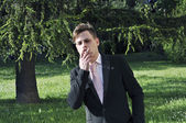 Businessman smoking — Foto Stock