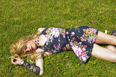 Drag queen lying on grass — Stock Photo