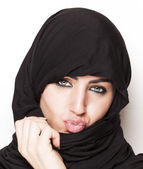 Transgressive girl wearing a burqa — Stock Photo