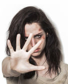 Beaten up girl asking to stop with strong look — Stock Photo