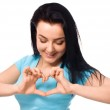 Beautiful young woman showing heart symbol gesture — Stock Photo #49182503