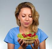 Woman holding raspberries — Stock Photo