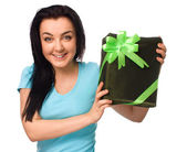 Woman holding gift box — Stock Photo