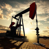 Oil pump on the sunset sky — Stock Photo