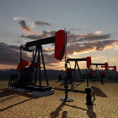 Oil pumps on the sunset sky — Stock Photo