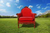 Red armchair in the desert — Stock Photo