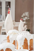 Easter cakes and cock are on kitchen — Stock Photo