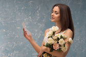 Girl with bunch of flowers — Stockfoto