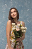 Girl with bunch of flowers — Stock Photo