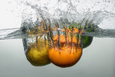 Fresh swimming fruits and vegetables — Stock Photo