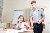 Two young architectures working at projective drawing — Stock Photo