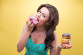 Sexy woman with sweets — Stock Photo
