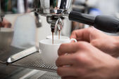 Barista and coffee machine — Stockfoto