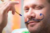 Painter and his art — Stock Photo