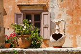 Flower vase on a background of a window. Greece. Crete — Stock Photo