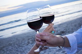 Romantic evening with glass of wine — Stock Photo