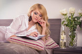 Woman writing notes in bedroom — Stock Photo