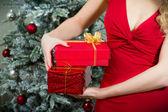 Woman holding christmas presents — Stock Photo
