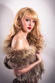 Model posing in fur vest — Stock Photo