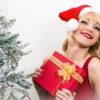 Pretty woman with christmas present — Stock Photo #45460655