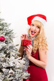 Pretty woman with christmas present — Stock Photo