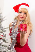 Woman with christmas present — Stock Photo