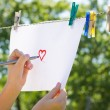 Girl drawing heart — Stock Photo #48636397