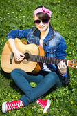Teenage girl with the guitar — Foto Stock