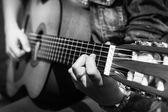 Girl plays a guitar — Stock Photo