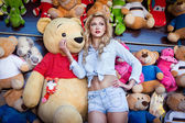 Girl in a store of soft toys — Stock Photo
