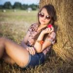 Teen girl on hay roll — Stock Photo #50299977