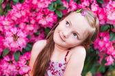 Cute little girl is daydreaming — Stock Photo