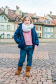 Cute little girl in a city on a nice day — Stock Photo