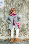 Portrait of a beautiful little girl in a grey coat — Stockfoto