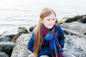 Portrait of a cute little girl next to lake on a nice day — Foto de Stock
