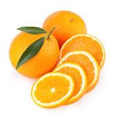 Ripe oranges with slices — Stockfoto
