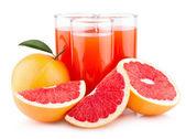 Ripe grapefruits with grapefruit juice — Stock Photo