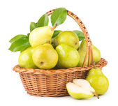 Green pears in a basket — Stock Photo