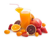 Tropical juice with fruits — Stock Photo