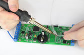 Repairing electronic board with reek — Stock Photo