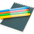 Felt-tip pens on notebook — Stock Photo