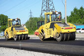Two yellow rolling machinery — Stock Photo