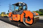 Orange rolling machinery side — Stock Photo