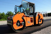 Orange rolling machinery making road — Stock Photo