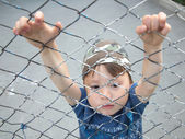 Boy hanging on the bars — Stock Photo