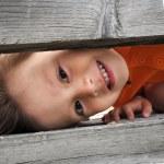 Boy playfull hiding — Stock Photo #49943849